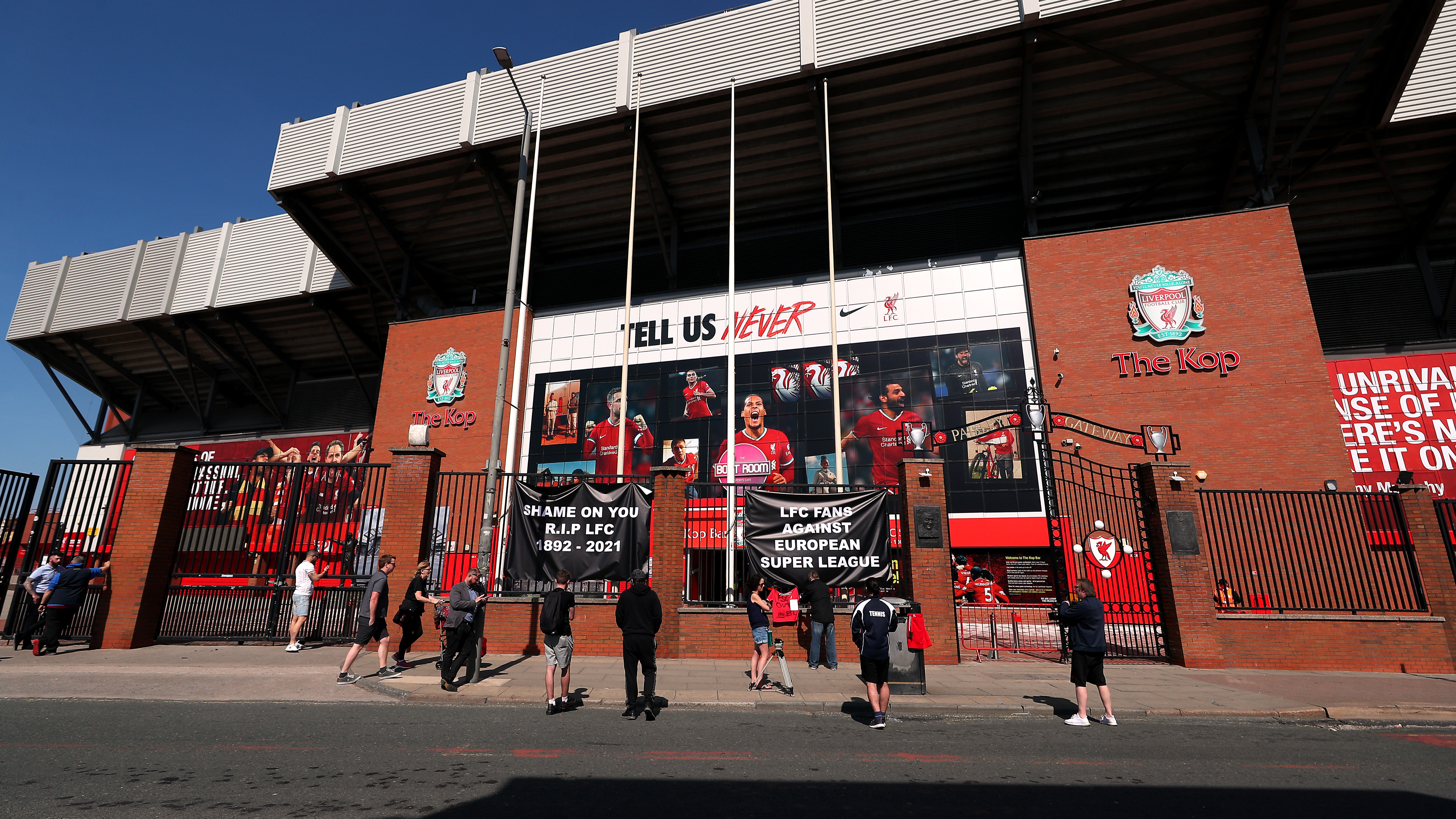 Liverpool Fans Put Up Banners Outside Of Anfield